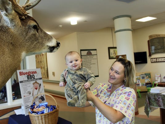Future hunter, Sawyer Peck, attends the Healthy Sportsman Health Fair with his mom, Ashley Keck.
