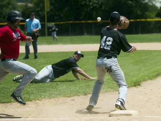 Biglerville's Bobby Weaver prepares to make the catch as Hanover's A.J. Phillips runs to first base during Game 3 of their South Penn playoff series Sunday at Diller Field. Hanover rallied to defeat Biglerville, 9-8, and advance to the semifinals.