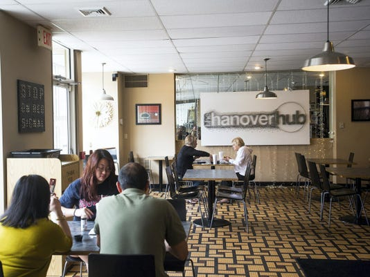 Late-afternoon lunch customers eat at the Hanover Hub in 2014.