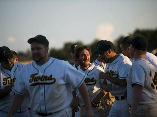 New Oxford's Davey Zaminski is congratulated by team members after he made the game-winning hit against Hanover on Thursday July 30, 2015 in the first game of the South Penn League championship series.  New Oxford beat Hanover 4-3.   Shane Dunlap - The Evening Sun