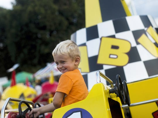 Trenton Stambaugh, 4, of Spring Grove, smiles as he passes his mom on the Baja Buggy ride in 2015 in Littlestown.