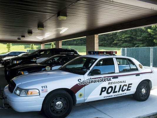 A row of Southwestern police vehicles are parked outside of the department's Spring Grove headquarters on Wednesday.