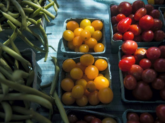 Sunlight falls on fresh tomatoes and green beans for sale from Five Points Market at the Adams County Farm Fresh Market on Steinwehr Avenue near Culp Street in Gettysburg on Wednesday.