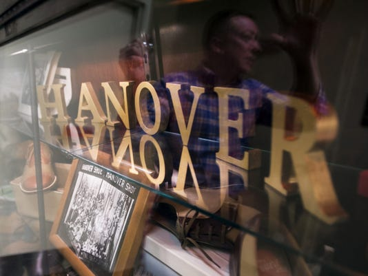 Clark's Bostonian Shoe Outlet assistant manager Donald Hamme talks about the display of items from the history of Hanover Shoe at Clark's in downtown Hanover. Hamme, who started working for Hanover Shoe in 1981, has been collecting the memorabilia for over 30 years