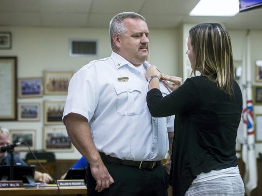 Anthony Clousher is pinned during his swearing-in ceremony as deputy fire chief during the Hanover Borough Council meeting Wednesday. Clousher was recommended by the Civil Service Commission to serve in the position for both Hanover borough and Penn Township.