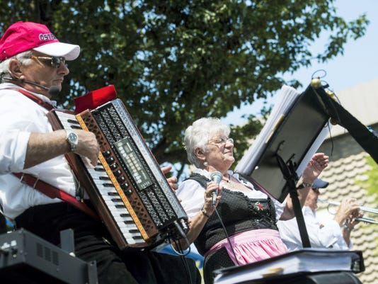 Emil Schanta, left, performs on the accordion while fellow band member and sister-in-law Anna Marie Schanta, from White Hall, sings traditional German folk music on Saturday during the Dutch Days festival in downtown Hanover.