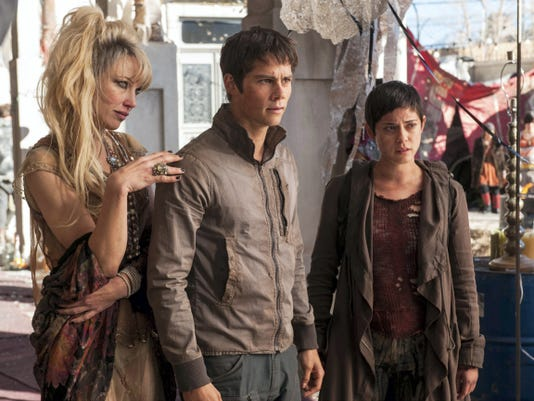 "In this image released by 20th Century Fox, Jenny Gabrielle, from left, Dylan O'Brien and Rosa Salazar appear in a scene from the film, ""Maze Runner: The Scorch Trials."""