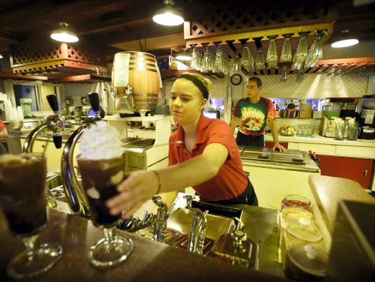 Maintaining the time honored soda fountain traditions the Jigger Shop in historic Mt. Gretna is celebrating 120 years in business. Tiana Menser, of Cedar Crest High School, fills orders at the summer hotspot in Mt. Gretna. Michael K. Dakota - Lebanon Daily News