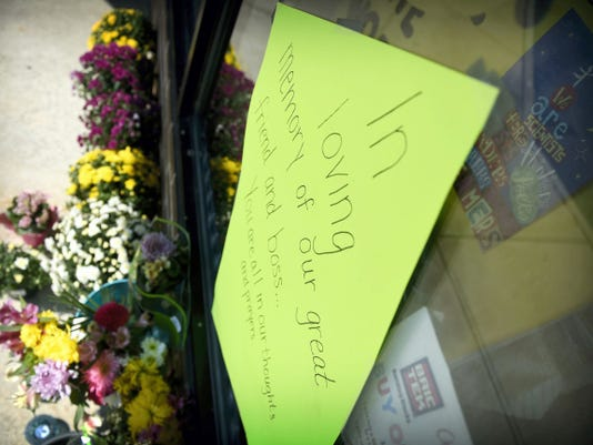 A sign expressing sympathy for the death of Stacey Pennington is taped to the window at Pennington's store in Cleona.
