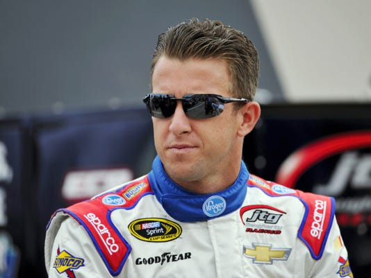 AJ Allmendinger waits by his car before qualifying for today's NASCAR Sprint Cup race at Watkins Glen International on Saturday. Allmendinger is the defending race winner.