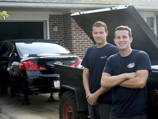 David Young, left, and Ryan Boyd, of Master Brakes Mobile, specialize in on-location vehicle repairs and maintainance. Pictured on Tuesday, August 18, 2015. Ryan Blackwell - Public Opinion