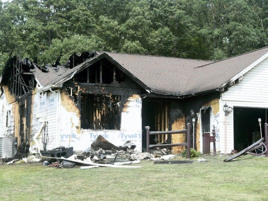 """Authorities say Christopher Rhone caused the fire that destroyed this house at 6503 Mountain Drive early Sunday because """"Grandma's house was dirty. I had to clean it."""""""