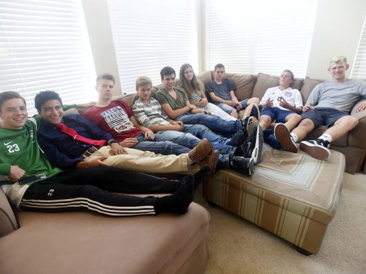 Sean McCormick, 15, left, Josue Chacon, 15, Johannes Janietz, 16, of Waldkraiburg Germany, Jakob Stolz,14, of Waldkraiburg, Korbinian Niedermeier, 16, Alina Redlich, 15, of Waldkraiburg, Manuel Demmelhuber, 15, of Waldkraiburg, Connor Gniewek, 15, and, Jack Martin, 18, hang out Thursday as part of the foreign exchange program between Waldkraiburg Germany and Chambersburg Area Senior High School.