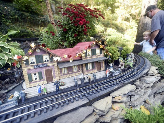 Visitors check out Les Tosten's model train setup during an open house Saturday at his home located at 3850 Wenger Road in Chambersburg.