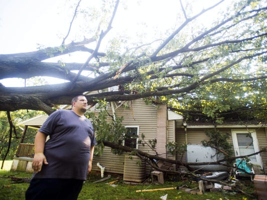 Joshua Drechsler says he managed to get his youngest child out of bed just as a tree fell on their home in the early hours of Aug. 4 in Mount Joy Township on Basehoar Roth Road in Adams County.