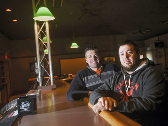 Bradley Miller, background, poses for a photo with his nephew, Nate Francisco, right, both of Gettysburg, at their new restaurant the Freckled Radish Irish Pub in Oxford Township.