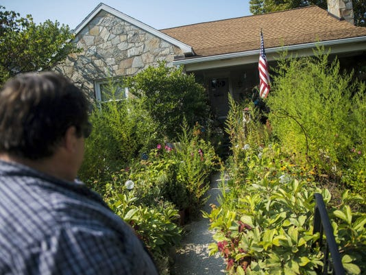 Richard Gladfelter pauses at the front walk of his home, which faces Meade Avenue, on Thursday.