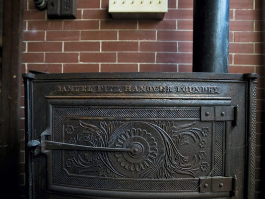 An eight-plate cast iron stove made by the Samuel Fitz company, which was located near Elm Avenue and High Street in Hanover, is part of a collection that will be displayed in the newly restored carriage house.