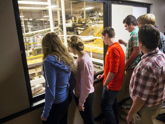South Western High School students watch potato chips being made on the factory floor during a tour of the High Street Utz plant on Wednesday.