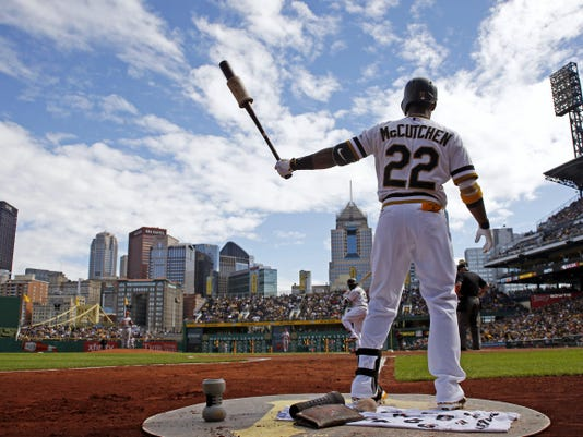 Pittsburgh's Andrew McCutchen warms up during Sunday's game against the Cincinnati Reds in Pittsburgh. The Pirates won, 4-0, and will host the Cubs on Wednesday in the NL wild-card matchup.