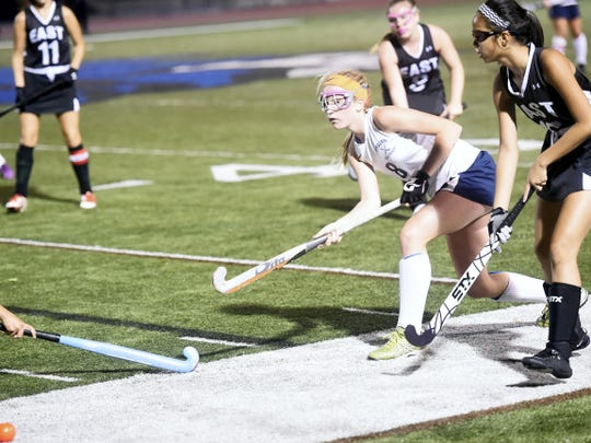 Chambersburg's Liza Ernst (8) passes against CD East