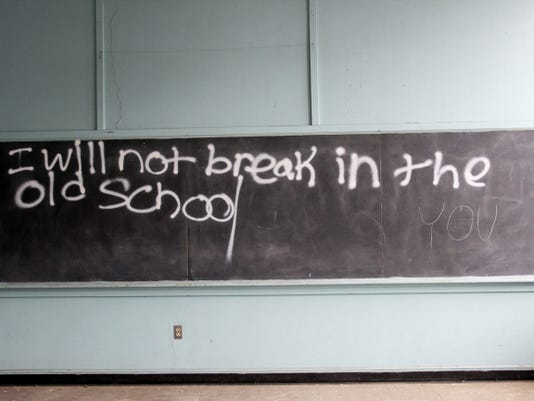 A chalkboard remains untouched from roughly 30 years ago Saturday at the Central Junior High School.