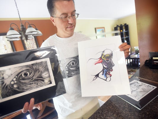 """Michael Paul Gavazzi shows prints of his graphic novel, """"Opaque,"""" after a successful release event on Sept. 30."""