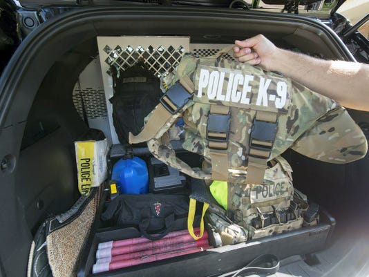 Tazer's bulletproof vest and gear are kept in the back of the Explorer at the Newberry Township Police Department.
