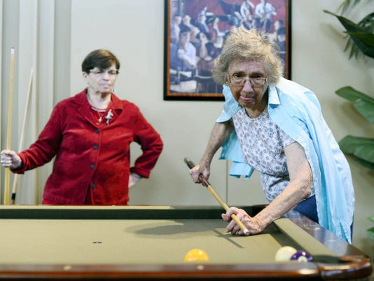 Joan Ashbrook, left, and Catherine Barnhart play pool during happy hour at Country Meadows Retirement Community in West Manchester Township. A recent data-set came out listing York County as the sixth-best county in the state in terms of preparedness of its residents for retirement.