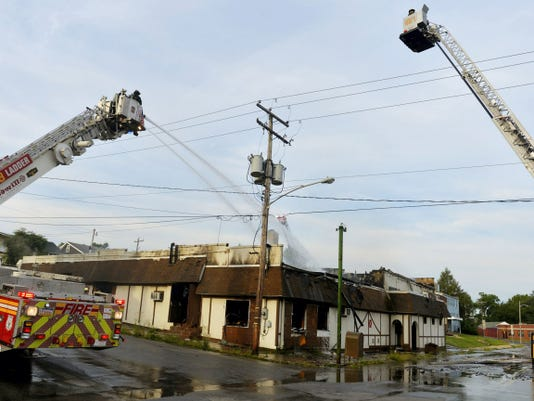 Chris Dunn - Daily Record/Sunday News   Firefighters attack a fire Aug. 6 at the former club at Manor and Lafayette streets in York.