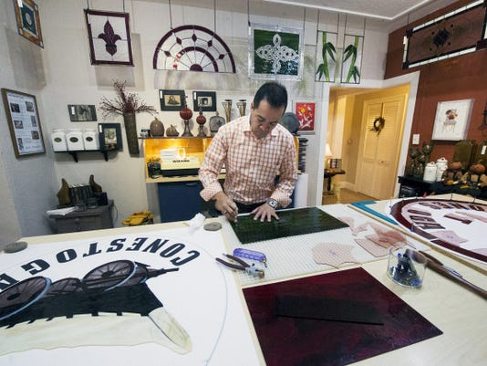 Hector Palma cuts glass at H&L Studio in York. He has been taking custom orders to hand-craft stained glass designs since he came to York. His studio is open by appointment or during open hours Saturdays from 9 a.m. to 3 p.m.