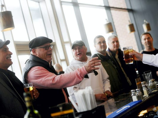 """Arizona Cardinals head coach Bruce Arians, second from left, mingles at BrewVino in York in March  after a ceremony honoring him at William Penn High School, his alma mater. Arians will be the subject of an upcoming episode of """"A Football Life,"""" and an NFL Films crew will visit York on Sunday to record video for the documentary."""