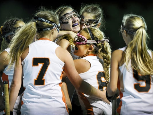 A happy group of Palmyra field hockey players celebrate their 1-0 victory over arch rival Lower Dauphin at In The Net on Monday night.