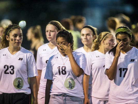Biglerville athletes react after the ceremony on the field Oct. 8 honoring the life of Meghan McKinney, a Biglerville High School alum who died in a car crash last week.