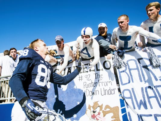 Penn State's Mike Gesicki high-fives fans after Penn State's 29-7 win against Indiana on Saturday at Beaver Stadium.