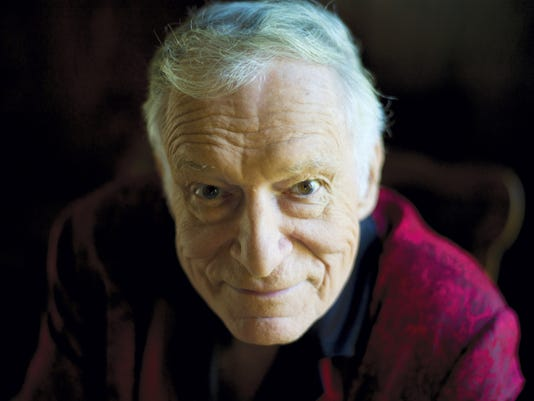 FILE - In this Oct. 13, 2011 file photo, American magazine publisher, founder and Chief Creative Officer of Playboy Enterprises, Hugh Hefner at his home (aka Playboy Mansion) in Beverly Hills, Calif. Playboy will no longer publish photos of nude women as part of a redesign of the decades-old magazine, according to a news report Monday, Oct. 12, 2015. Executives for the magazine company told The New York Times that the change will take place in March 2016. Playboy editor Cory Jones contacted current editor in chief Hefner recently about dropping nude photos from the print edition and he agreed, the Times reported. (AP Photo/Kristian Dowling, File)