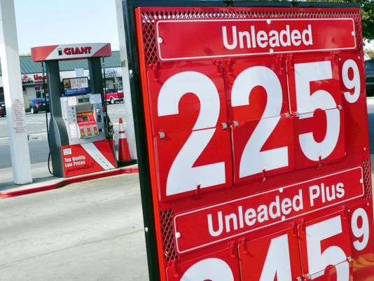 Local gas prices continue to drop, as seen at this Wayne Avenue Giant, Tuesday.