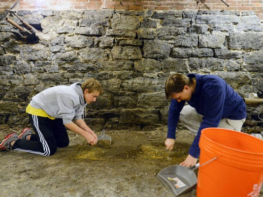 York Suburban sophomore Alan Countess, 16, and York College adjunct professor and anthropologist Ben Luley use trowels to excavate the top layer of fill during a test dig in the basement of the old York train station on East North Street in York on Saturday. Countess, several of his friends and Luley plan to conduct an archaeological dig of the basement floor this summer.