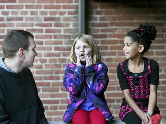Chambersburg Mayor Darren Brown, left, meets Riley Gumpher, 8, of McConnellsburg and Mya Trotty, 8, of Chambersburg on Friday before showing children Borough Council chambers.