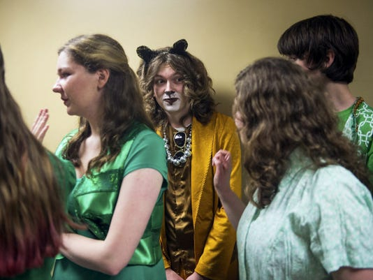 """Gettysburg's Nick Wallace, who plays the Lion in Gettysburg Area High School's performance of """"The Wiz,"""" chats with cast members on May 17."""