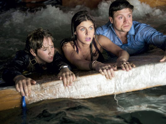 """This photo provided by Warner Bros. Pictures shows, from left, Art Parkinson as Ollie, Alexandra Daddario as Blake, and Hugo Johnstone-Burt as Ben, in a scene from the action thriller, """"San Andreas."""" The movie releases in theaters on May 29, 2015."""