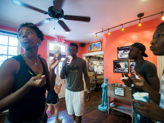 From left, Dede Williams, Daniel West, Darryl West and Marco Williams enjoy homemade ice cream at Mr. G's Ice Cream on June 23 on Baltimore Street in downtown Gettysburg.