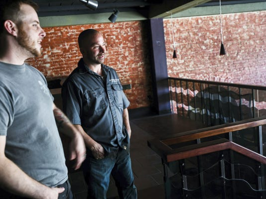 Alex Slagle, left, owner of The Hanover Hub, and Brent Stambaugh, co-owner of Miscreation Brewing Company, talk inside the new property leased for Miscreation Brewing Company at the corner of Carlise Street and Broadway in downtown Hanover.