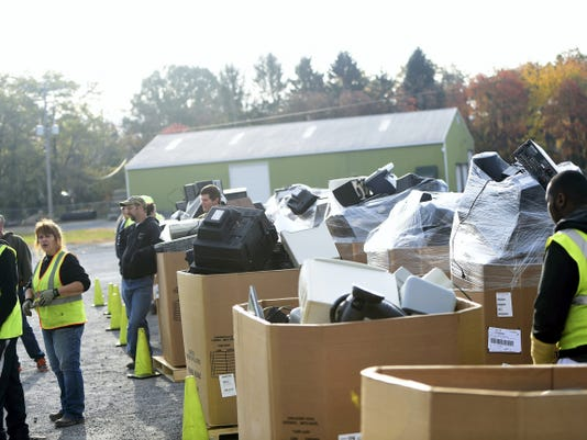 Hundreds of old TVss are brought in during Southampton Township's regional electronic recycling collection event on Saturday.