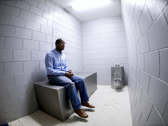 Lebanon Valley College junior Daniel Thompson, a sociology and criminal justice major with a minor in law and society, sits in a solitary confinement cell set up in Miller Chapel on Friday.