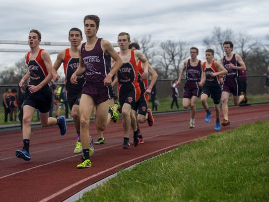 York Suburban and Gettysburg High School athletes compete in the boys' 1,600-meter race Tuesday at Gettysburg High School. Gettysburg's Dan Filler finished ahead of York Suburban's Brady Wilt with a winning time of 4 minutes, 32.2 seconds.