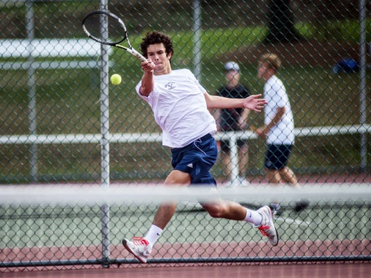 Dallastown's John Schmitt returns a shot during Wednesday's singles match against South Western's Gavin Kenny. Schmitt won that match, but South Western earned a 4-3 win to secure at least a share of the YAIAA Division I title.