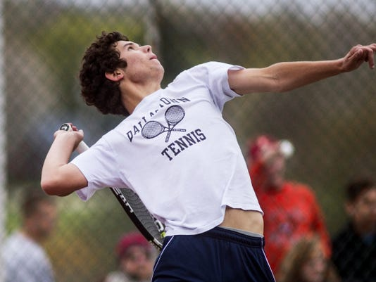 Dallastown's John Schmitt serves during the Class AAA boys' tennis championship game against Red Lion's Sam Innerst on Monday. Schmitt beat Innerst, 4-6, 6-0, 6-1, for his second consecutive championship.