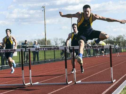 Derek Zurin of Eastern York clears one of the last hurdles as he heads into the finish line during the 300-meter hurdle event on Tuesday.