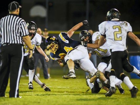 Littlestown's Zach Brown breaks from Biglerville's defense on the carry during football Friday Oct. 17, 2014 at Littlestown Area High School.  Shane Dunlap - GameTimePA